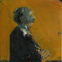 Man with hands clasped