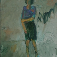 Woman holding right arm