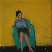 Woman on green armchair
