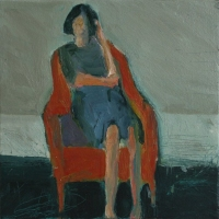 Woman on red armchair