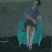 Woman on blue armchair
